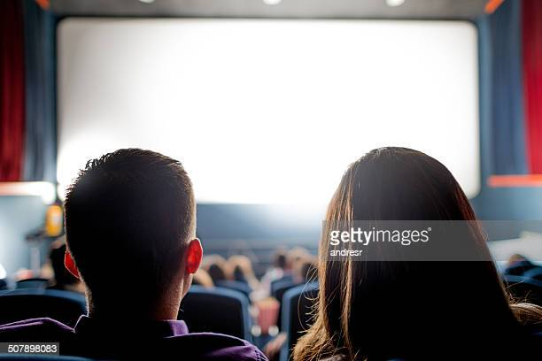 people at the cinema - projection screen stock pictures, royalty-free photos & images