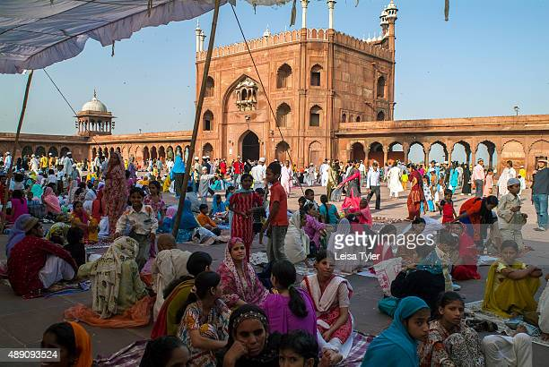People at the courtyard waiting for Friday prayer at the Jama Masjid in Delhi built between 1644 and 1656 by Mughal emperor Shah Jahan