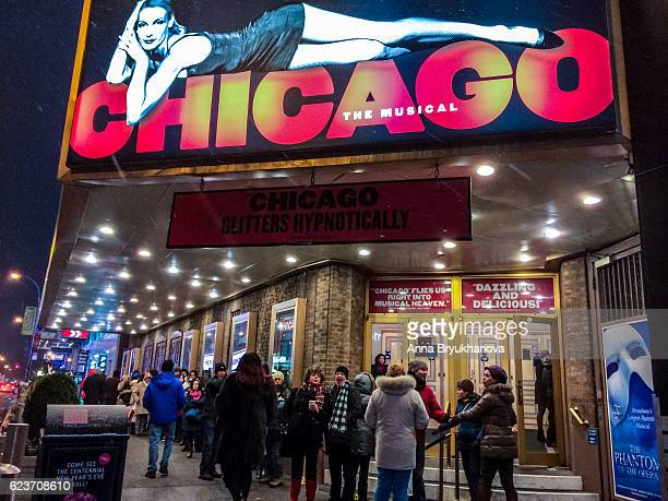people at the entrance to broadway theater for chicago musical - chicago musical stock pictures, royalty-free photos & images