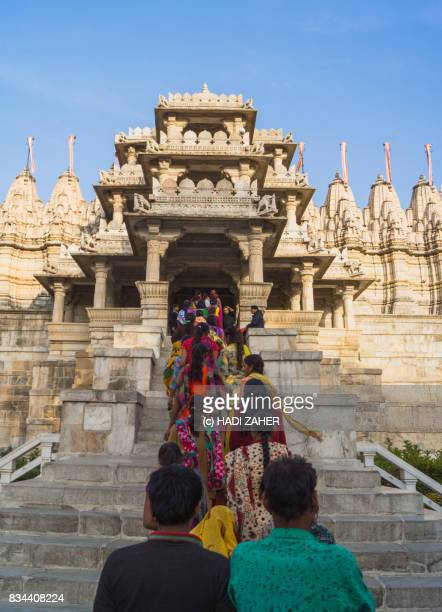people at the entrance to ranakpur jain temple | rajasthan | india - ranakpur temple stock photos and pictures