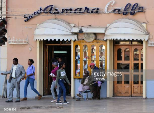 people at the ever busy sweet asmara cafe - harnet avenue, asmara, eritrea - asmara stock pictures, royalty-free photos & images