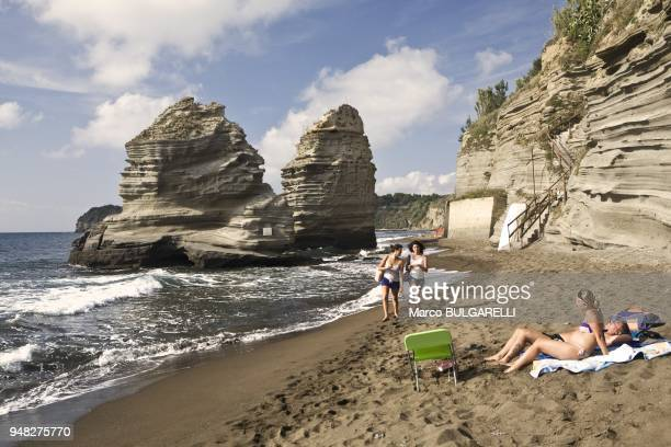 People at the faraglioni beach on June 11 2012 in Procida Italy