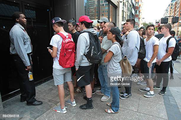 People at the front of the line wait to get into the store as a popup store selling clothing linked to Kanye West's album The Life of Pablo had fans...