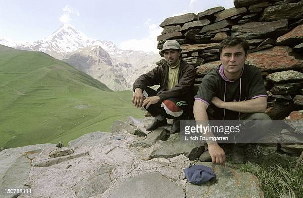 People at the GeorgiaRussian border In the background the mountain Kazbek which with a height of 5047 m is one of the highest mountain in the...