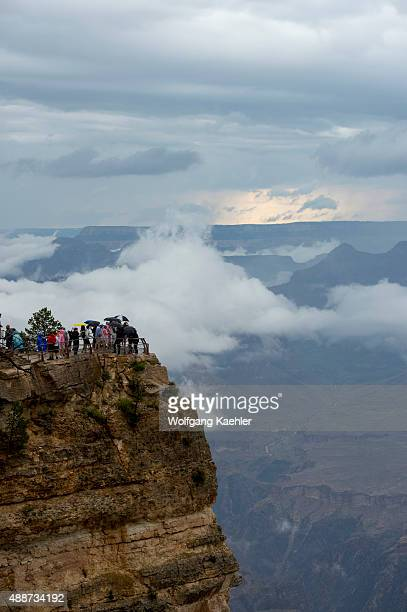 People at the Grand Canyon South Rim near Mather Point during a thunderstorm Grand Canyon National Park in northern Arizona USA
