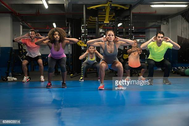 People at the gym in an aerobics class