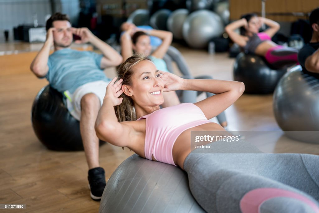 People at the gym in an exercise class using fitness balls : Stock Photo