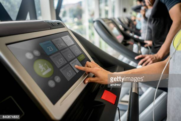 people at the gym setting up the treadmill - treadmill stock pictures, royalty-free photos & images