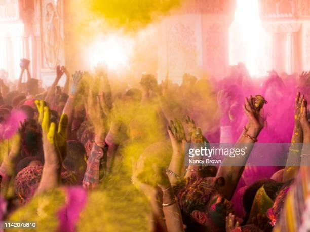 people at the hindu holi festival in india. - holi stock-fotos und bilder
