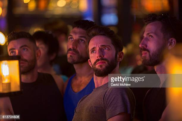 People at the LGBTfriendly Bar 10 react to comments made by Donald Trump during the second presidential debate between Republican presidential...