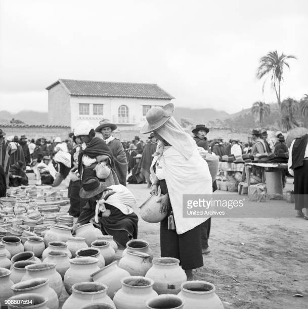 People at the market in the city of Otavalo, Ecuador 1960s.