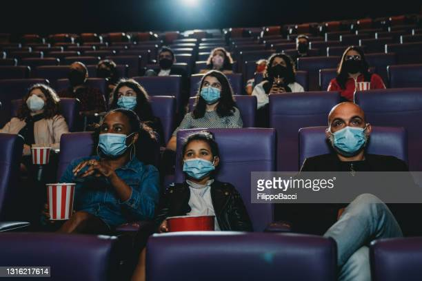 people at the movie theater watching a movie - film industry stock pictures, royalty-free photos & images