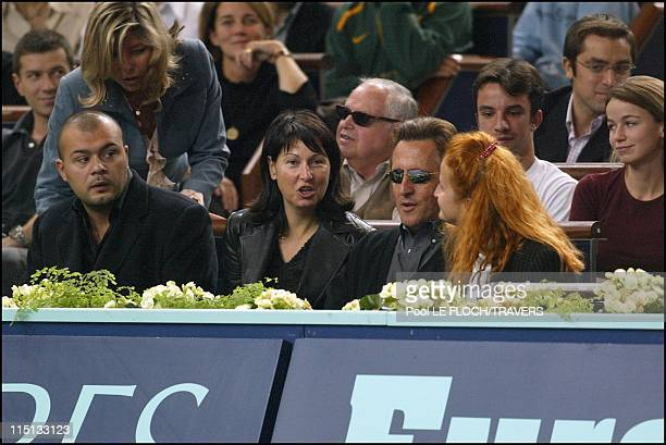 People at the Paribas tennis master men final in Paris France on November 03 2002 Evelyne Thomas and friend Christophe Gilbert Montagne and wife