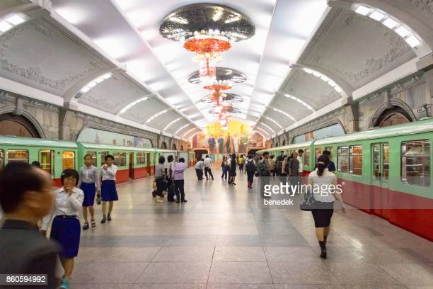 people at the pyongyang subway in north korea - pyongyang stock pictures, royalty-free photos & images