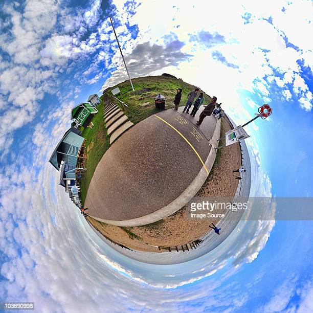People at the seaside with little planet effect