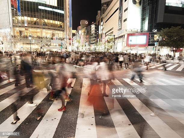 people at the shibuya crossing, tokyo - moving past stock pictures, royalty-free photos & images