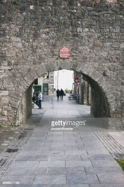 People at the Spanish Arch in Galway, Ireland.