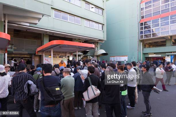 People at the tips counters to listen the horse racing tips at Ohi Racecourse during the JBC race day in Tokyo Japan on November 3 2015 JBC race day...