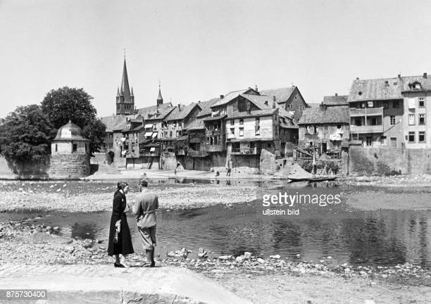 People at the waterside of the Nahe river in the background the Old Town houses Wolff Tritschler Vintage property of ullstein bild