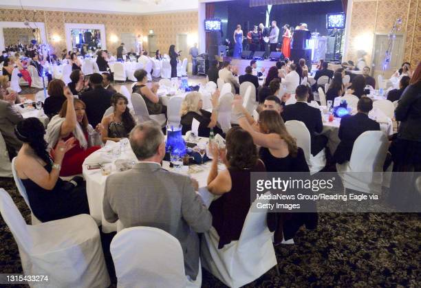 People at their tables in the banquet room. At the Abraham Lincoln Hotel in Reading Friday night for the Dominican American Union Christmas Gala. The...