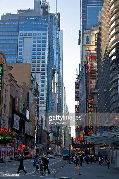 people at times square with city lights - marriott marquis new york stock photos and pictures
