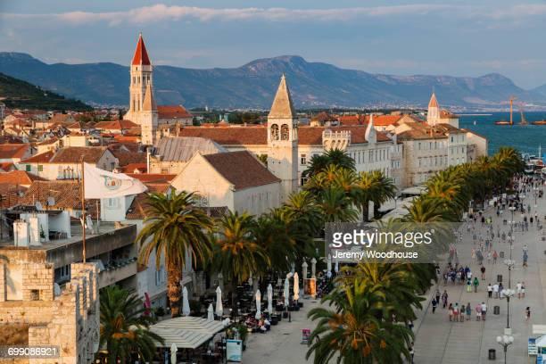 people at urban waterfront, trogir, dalmatia, croatia - cetacea stock photos and pictures