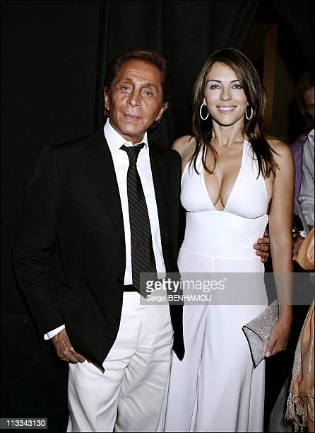 People At Valentino FallWinter 20062007 Haute Couture Show In Paris On July 5Th 2006 In Paris France Here Valentino And Liz Hurley