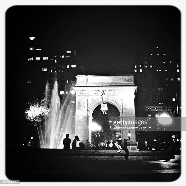 people at washington square arch during night - washington square park stock pictures, royalty-free photos & images