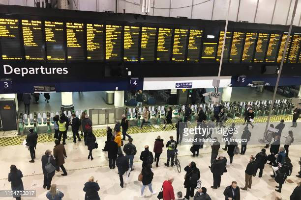 People at Waterloo Station in London after trains were brought to a standstill during rush hour resulting in hundreds of commuters being packed into...