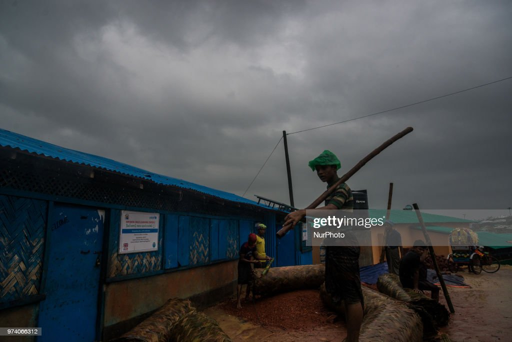People at work in the flooded rohingya makeshift shelterr at kutupalong in Coxs Bazar, Bangladesh on June 13, 2018.