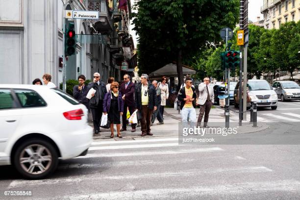 people at zebra crossing in street viale papa giovanni xxiii - papa giovanni xxiii stock pictures, royalty-free photos & images