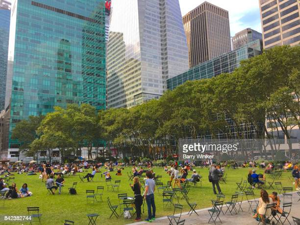 people atop lawn at bryant park, new york - bryant park stock pictures, royalty-free photos & images