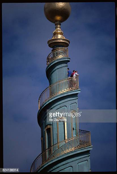 People atop Our Savior's Church Spire