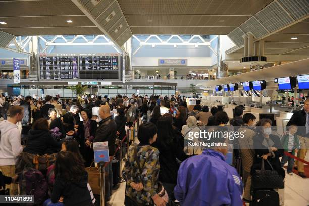 People attempting to evacuate from Japan fill Narita International Airport on March 18 2011 in Narita Chiba Japan Thousands have been killed as a...