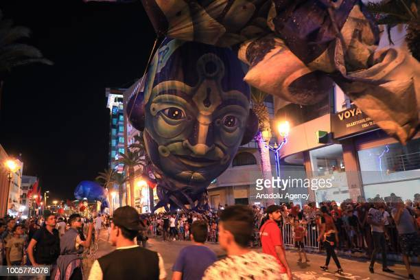 People attend 59th The Carnival of Awussu which is a traditional festival symbolizes summer months at Hedi Chaker Avenue in Sousse Tunisia on July 26...
