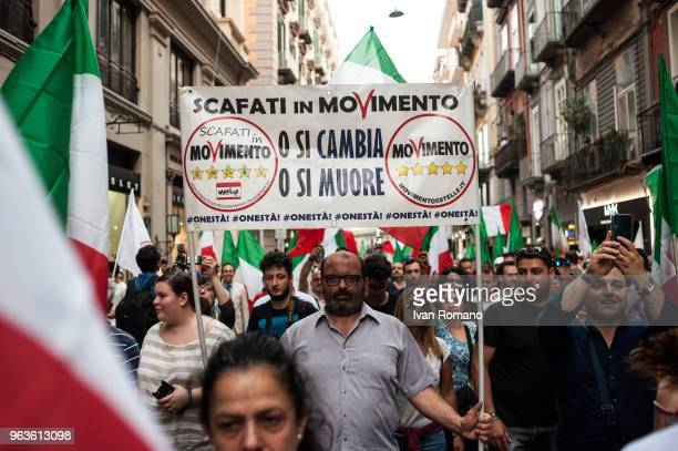 People attend a 5 Star Movement rally on May 29 2018 in Naples Italy Political uncertainty continues in Italy after its President Sergio Mattarella...