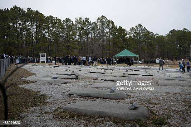 People attend a burial February 12 2015 in Wendell North Carolina More than 5000 people gathered for the funeral of Deah Shaddy Barakat his wife...