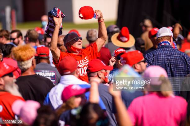 People attend a campaign rally for President Donald Trump on October 24, 2020 in Lumberton, North Carolina. President Trump has expressed his support...