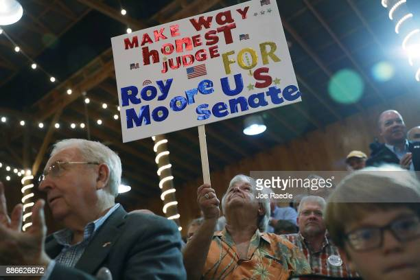 People attend a campaign rally for Republican Senatorial candidate Roy Moore at Oak Hollow Farm on December 5 2017 in Fairhope Alabama Mr Moore is...