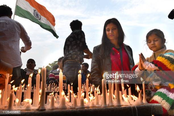 People attend a candle light vigil organised by NDMC to pay tribute to CRPF personnel who were killed in the Pulwama terror attack at Connaught Place...