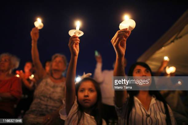 People attend a candlelight prayer vigil outside Immanuel Baptist Church located near the scene of a mass shooting which left at least 22 people dead...
