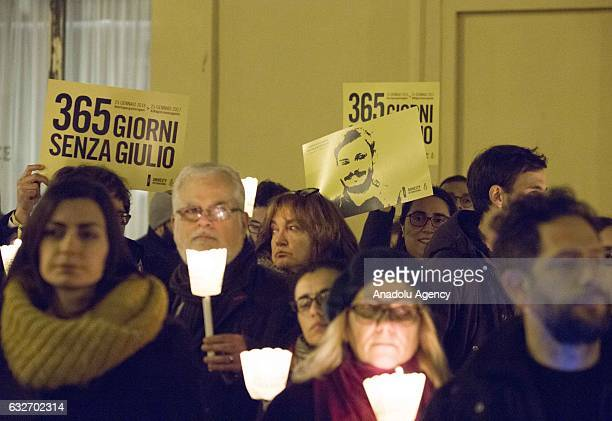 People attend a candlelight procession during the first anniversary of the disappearing of Giulio Regeni, the Italian student abducted, tortured and...