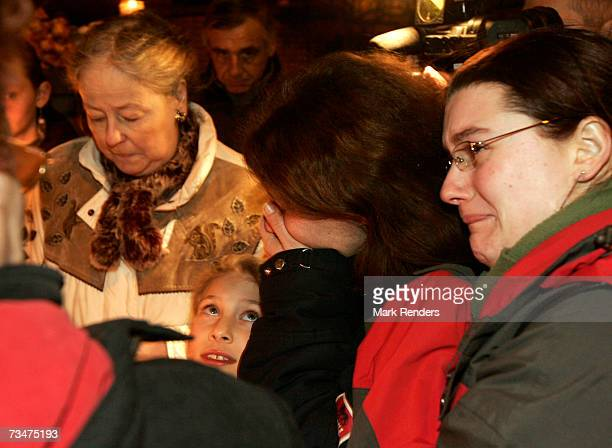 People attend a candlelight vigil and extend their sympathy at the entrance of the house of the Mokadem family at the General Jaques Avenue March 2...