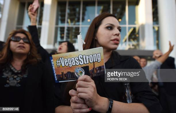 TOPSHOT People attend a candlelight vigil at Las Vegas City Hall October 2 after a gunman killed at least 58 people and wounded more than 500 others...