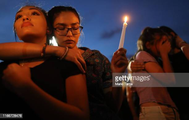 People attend a candlelight vigil at the makeshift memorial honoring victims of a mass shooting which left at least 22 people dead on August 7 2019...