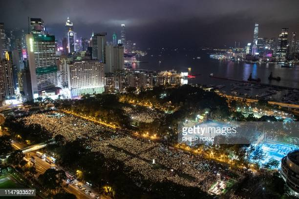 People attend a candlelight vigil at Victoria Park in Hong Kong on June 4 to mark the 30th anniversary of the 1989 Tiananmen crackdown in Beijing The...