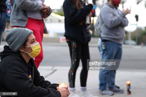 People attend a candlelight vigil for Andrew Brown, Ma'khia Bryant and Daunte Wright at The Laugh Factory on April 23, 2021 in West Hollywood,...