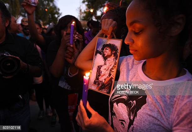 TOPSHOT People attend a candlelight vigil for pop music icon Prince April 21 2016 at Leimert Park in Los Angeles California Emergency personnel tried...