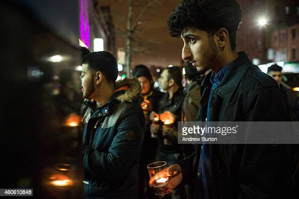 People attend a candlelight vigil for the 132 students killed in a terror attack yesterday in Pakistan on December 17 2014 in the Midwood...