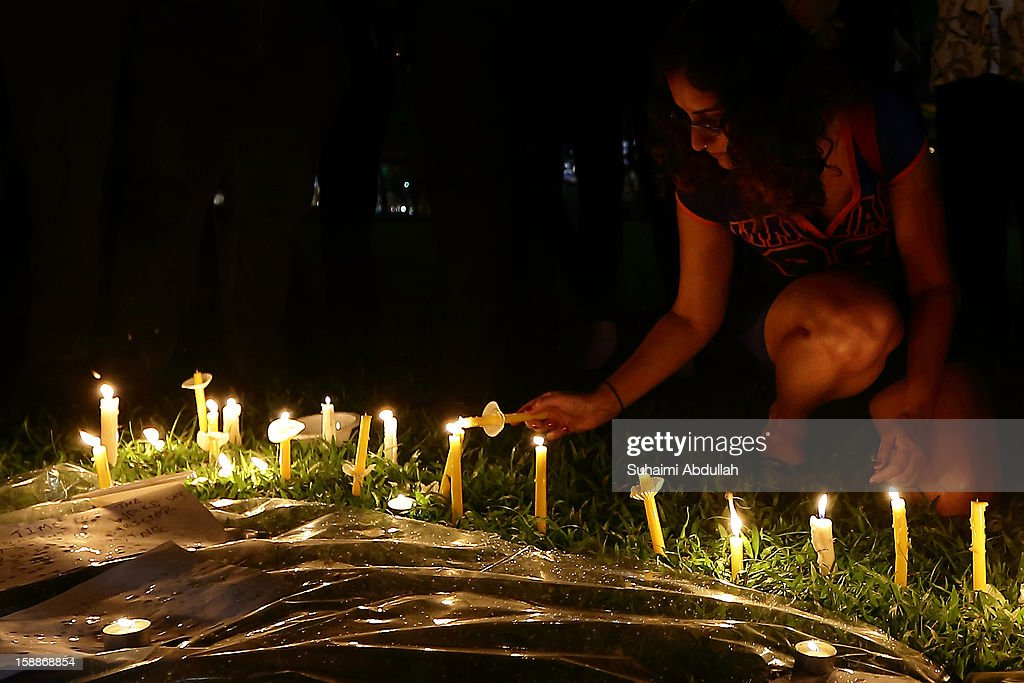 People attend a candlelight vigil in honor of the memory of the gang rape victim, a 23-year-old medical student, at Hong Lim Park on January 2, 2013 in Singapore. The victim of a gang rape and murder which triggered an outpouring of grief and anger across India died on December 29, 2012 after she was flown in to Singapore for treatment following her severe injuries.